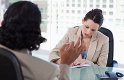 Manager interviewing a male applicant Royalty Free Stock Photos