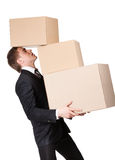 Manager keeping pile of pasteboard boxes Royalty Free Stock Images
