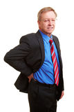 Manager with kidney pain. Elderly businessman holding his hand to his aching back royalty free stock photos