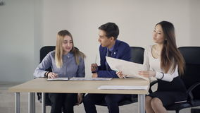 Manager late arrival on the business meeting with colleagues in the office. stock footage