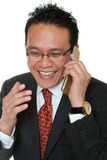 Manager laughs while phoning Royalty Free Stock Image