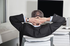 Manager leaning back in office Stock Photos