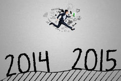 Manager leap through number 2014 to 2015. Female businessperson running through number 2014 to 2015 against grey background stock illustration