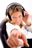 Manager listening music and pointing at camera Royalty Free Stock Photos