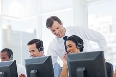 Manager listening to call centre employee stock photos