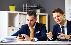 Manager listening to his colleague explanations Stock Photos