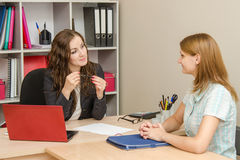 The manager listens attentively to a client Royalty Free Stock Image