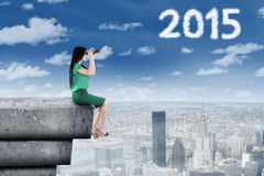 Manager looking at number 2015 with binocular Stock Photography
