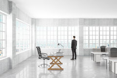 Manager looking to the window in a open space office Royalty Free Stock Image
