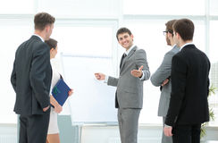 Manager makes the presentation of a new project for employees Royalty Free Stock Photo