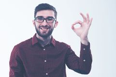 Manager making the gesture OK on a white background. Successful Manager making the gesture OK on a white background.the photo has a empty space for your text stock image