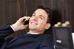 Manager making phone call in hotel room Royalty Free Stock Photos