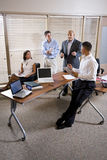 Manager meeting with office workers, directing Royalty Free Stock Photos