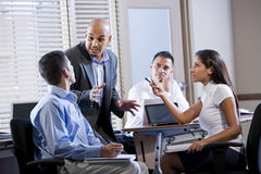 Manager meeting with office workers, directing Stock Image