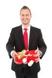 Manager met Kerstmisgift - mens op witte achtergrond wordt geïsoleerd die Royalty-vrije Stock Afbeeldingen