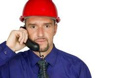 Manager met oortelefoon en helm Royalty-vrije Stock Fotografie