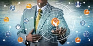 Manager Monitoring Smart Water Grid Via AI And IoT. Unrecognizable industrial manager monitoring a smart water grid via artificial intelligence and IoT royalty free stock photography
