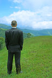 Manager in the mountains. Manager staying in the mountains and thinking Stock Image