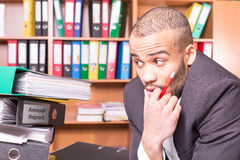 Manager in office fear to get additional work Royalty Free Stock Photography