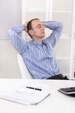 Manager at office taking his break and dreaming. Stock Image