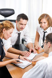 Manager with office workers Stock Image