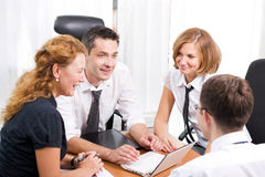 Manager with office workers in board room Royalty Free Stock Photo
