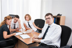 Manager with office workers in board room Stock Images