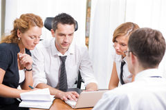 Manager with office workers on meeting Royalty Free Stock Photo
