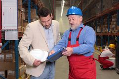 Manager+older worker+warehouse Stock Photography