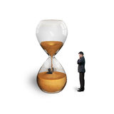 Manager oversee employee flooded in hourglass isolated on white. Manager oversee employee flooded in hourglass stock image