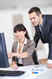 Manager overseeing business woman Royalty Free Stock Photography