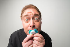 Manager with pacifier Stock Photography