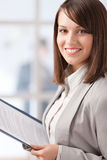 Manager with pad on the glass wall background. With people Stock Photos
