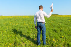 Manager with papers out in field Stock Photos