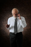 Manager in phone Royalty Free Stock Image