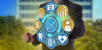Manager Planning For Higher Quality Health Care. Unrecognizable healthcare administrator activating icons for higher quality care and lower expenses. Information Stock Photo