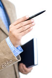 Manager pointing with a pen. Manager holding agenda, during meeting, pointing with a pen Royalty Free Stock Image