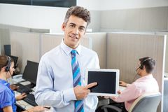 Manager Pointing At Tablet Computer In Call Center Stock Image
