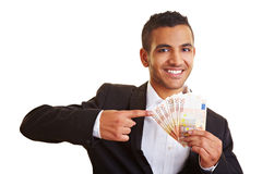 Manager pointing to banknotes Royalty Free Stock Photo