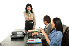 Manager pointing to business woman Stock Photo