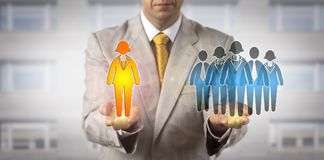 Manager Presenting Female Leader To Work Team. Unrecognizable manager is presenting one female white collar worker icon to a group of employee symbols. HR Stock Photos