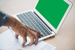 Manager push enter button on laptop to input the data. Chroma key green screen display royalty free stock images