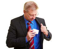 Manager putting business card Royalty Free Stock Images