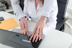 Manager putting his hands on the hands of his secretary Stock Image