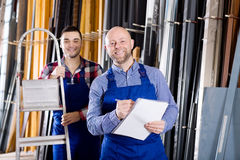 Manager at PVC windows factory. Cheerful manager approving employee work at PVC windows factory royalty free stock image