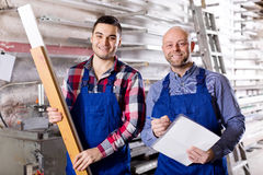 Manager at PVC windows factory. Manager and worker approving work at PVC windows factory royalty free stock photos