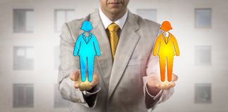 Manager Ranking Two Female Workers On Same Level. Unrecognizable human resources manager ranking two female employees on the same level in his hands. Staffing royalty free stock photos