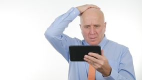 Manager Read Financial Bad News on Touch Tablet and Gesticulate Disappointed.  royalty free stock images