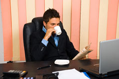 Manager reading news in his office Stock Image