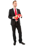 Manager ready for Christmas - man isolated on white background. Manager standing with Christmas gift. Business man with present ready for New Year Stock Image